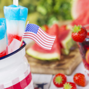 Fourth of July celebration decorations mixed with picnic drinks and popsicles.
