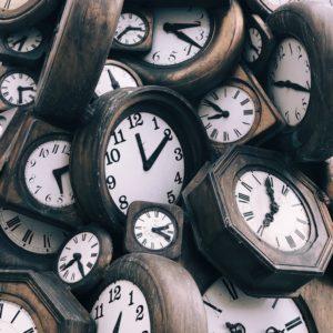 Pile of wooden clocks