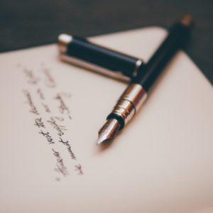 Fancy pen on paper