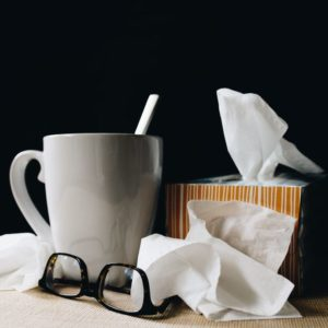 Mug, glasses, and tissue box