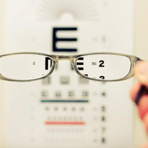View of eye test chart through prescription glasses
