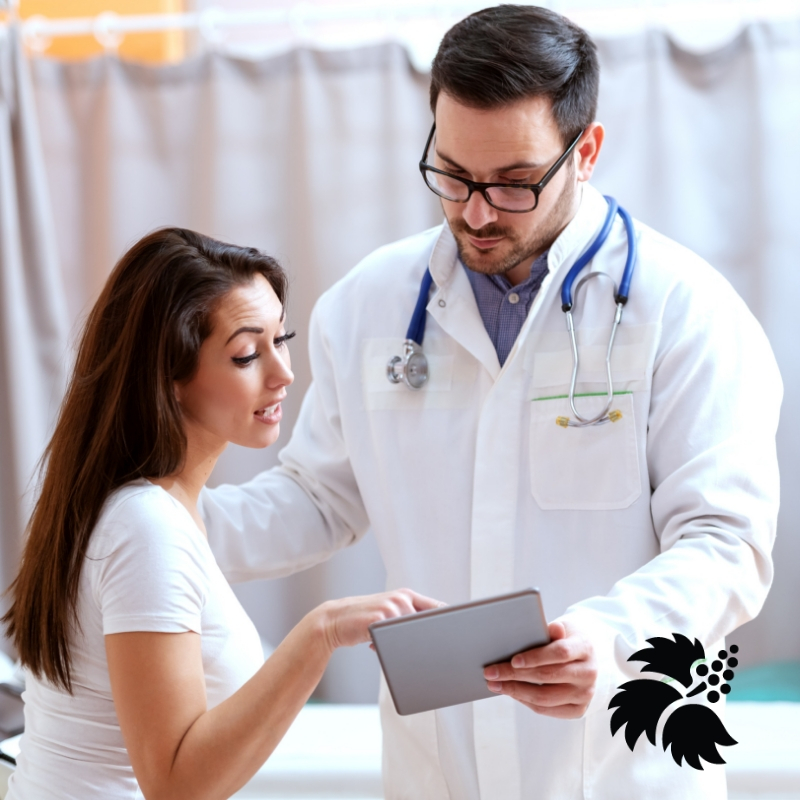 Image of young woman talking with her doctor